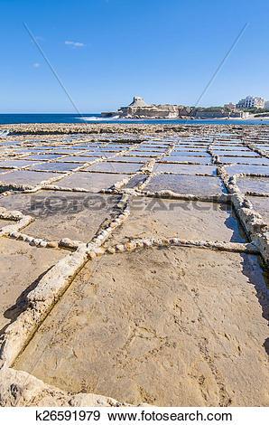 Stock Photograph of Salt pans near Qbajjar in Gozo, Malta.