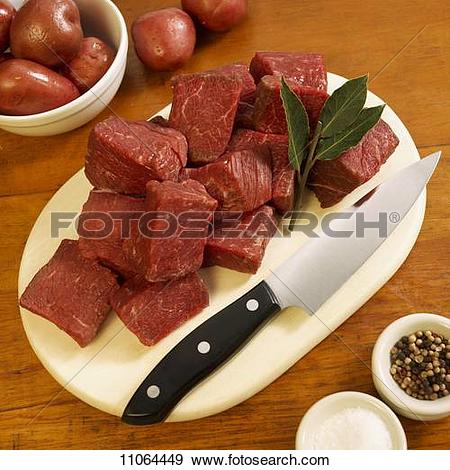 Stock Photograph of Cubed Grass Fed Beef Sirloin Tips on Cutting.
