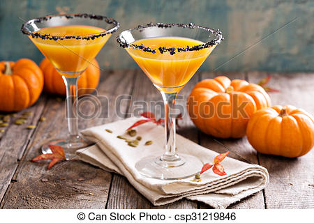 Stock Photo of Pumpkintini pumpkin martini coctail with black salt.