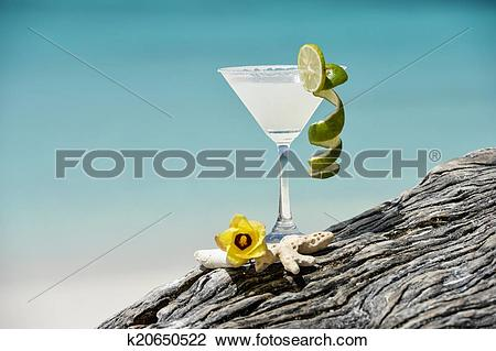 Stock Photo of Margarita with salt and lemon on glass rim.