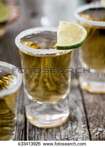 Stock Images of Tequila shots with salt rim k33413926.