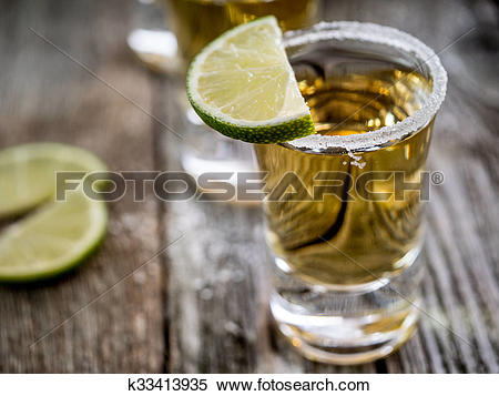 Stock Image of Tequila shots with salt rim k33413935.