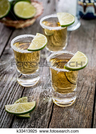 Stock Image of Tequila shots with salt rim k33413925.