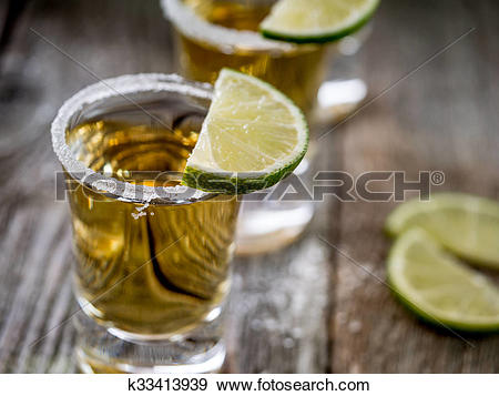 Stock Photograph of Tequila shots with salt rim k33413939.