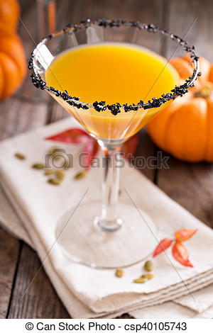 Stock Photo of Pumpkin martini cocktail with black salt rim.
