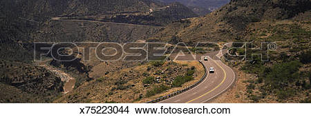 Stock Photo of Cars driving through winding roads of canyon, Salt.