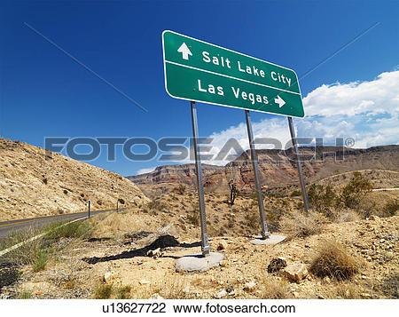 Stock Photo of Road sign in desert pointing towards Salt Lake City.