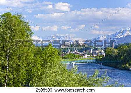 Stock Images of Trees at riverside with castle in background.