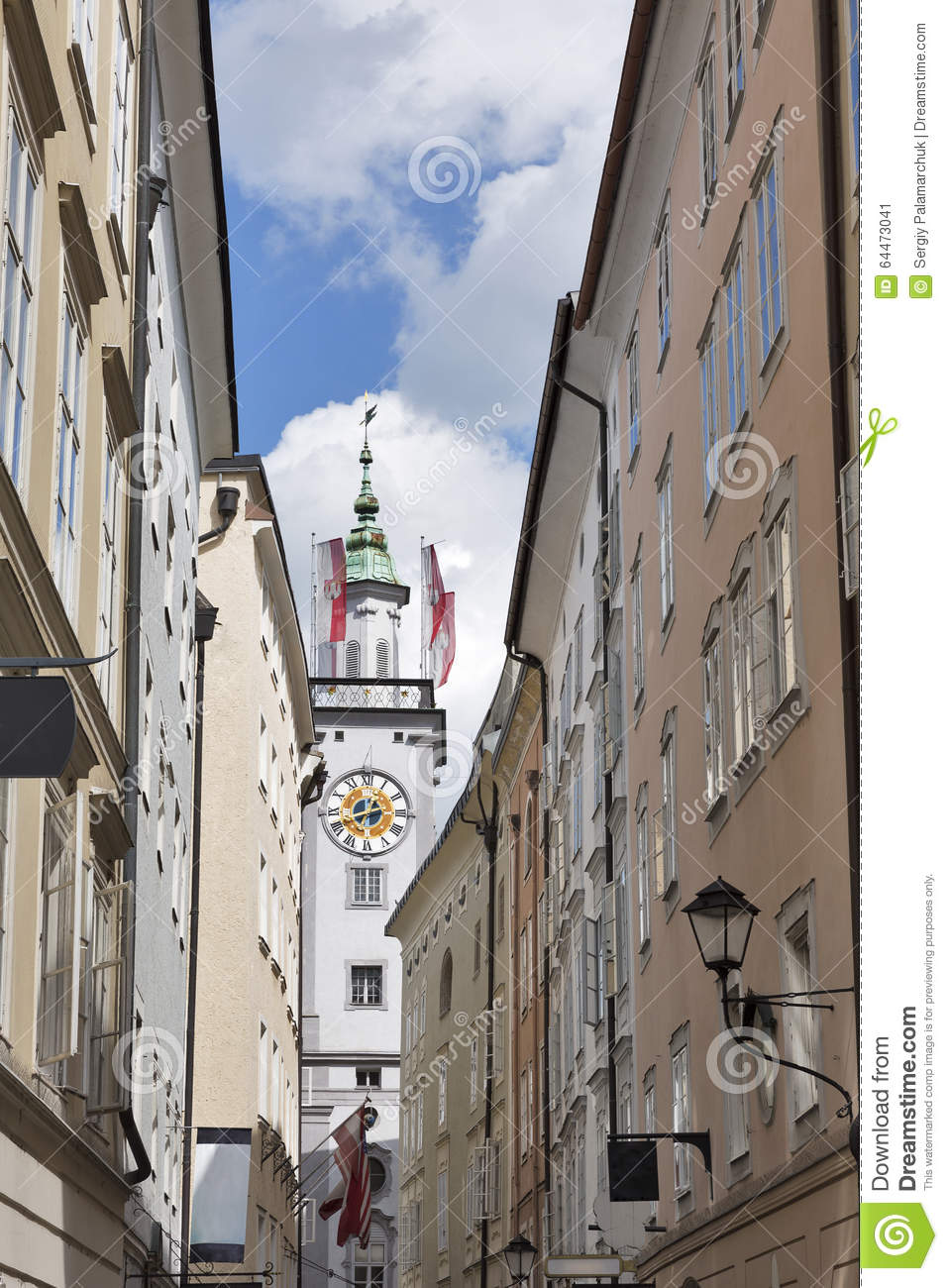 Clock Tower Of Old Town Hall With Flags In Salzburg, Austria.