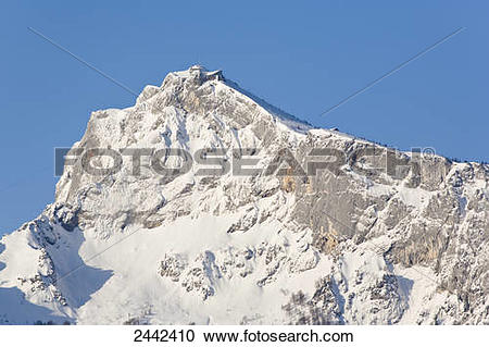 Stock Photography of Snowcapped mountain under blue sky.