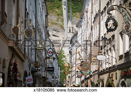 Stock Image of Austria, Salzburg, old town, shop signs in street.