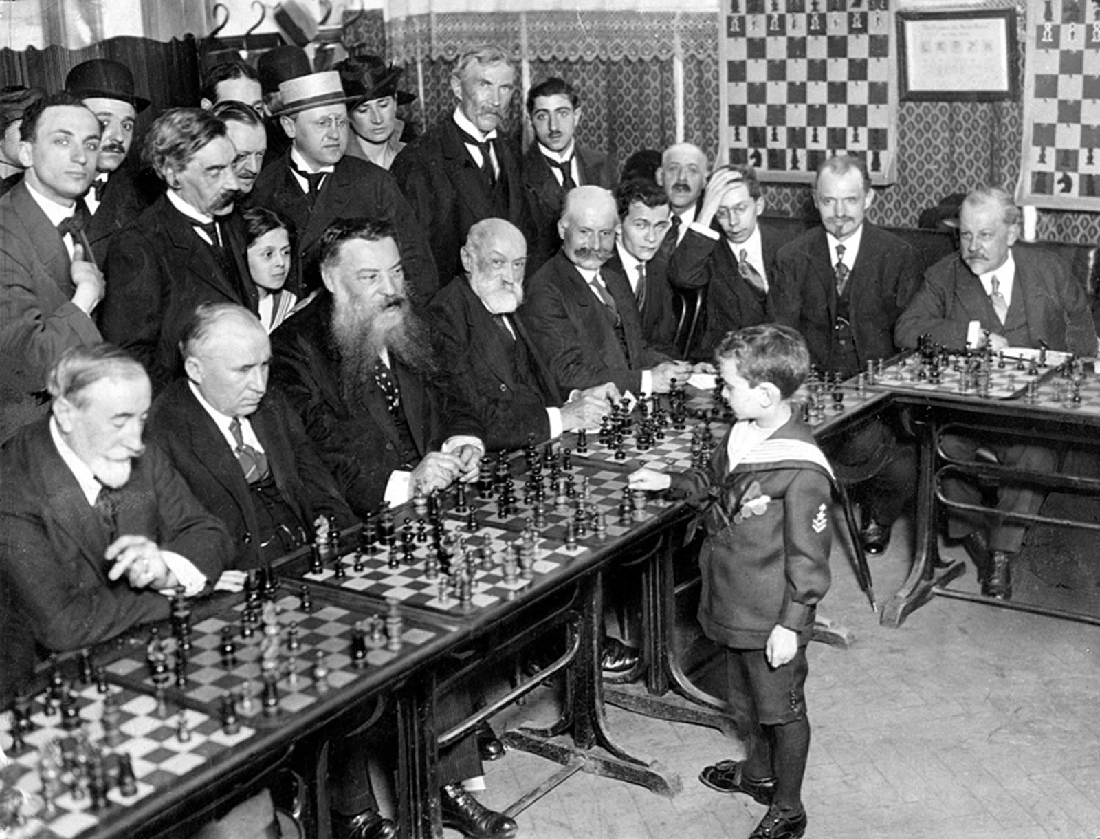 Samuel Reshevsky, age 8, defeating several chess masters at once.