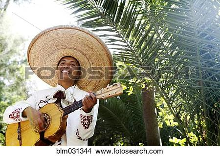 Stock Photo of Musician playing in mariachi band, San Miguel de.