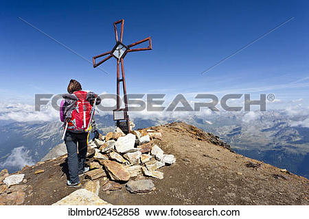 "Pictures of ""Mountain climber at the summit cross on Schneebiger."