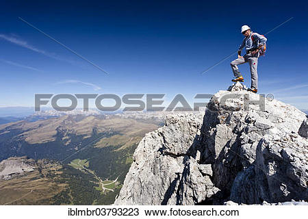 "Stock Photo of ""Mountain climber on the summit of Cima di Vezzana."