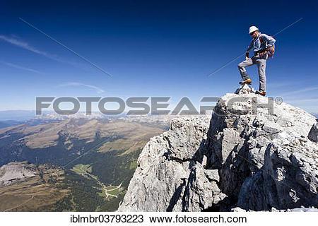 "Stock Photo of ""Mountain climber on the summit of Cima di Vezzana."