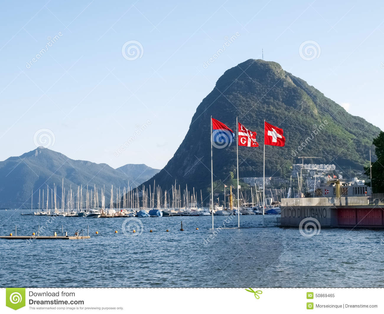 Lake Lugano, Monte San Salvatore ,and The Flags Of Switzerland.