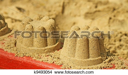 Stock Photo of A sand cake on the sand on a white background.