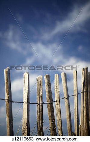 Stock Photo of England, Devon, Bantham. Wooden fence posts marking.