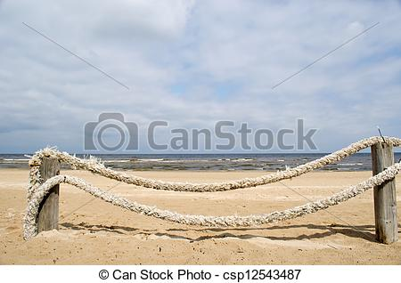 Pictures of rope log fence beach sand.