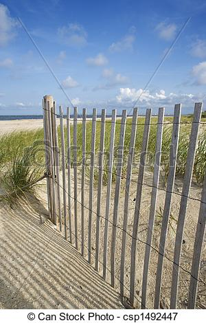 Picture of Weathered wooden fence on sand dune. csp1492447.