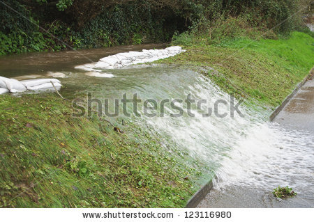 Overflowing River Bank Flood Sand Bags Stock Photo 123116980.