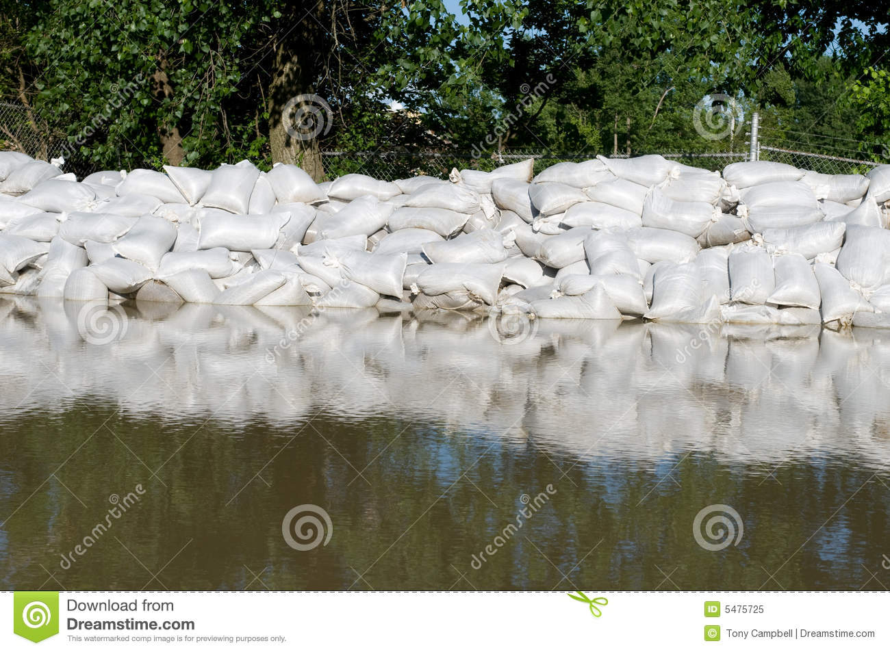 Sand Bags And Flood Water Royalty Free Stock Photo.