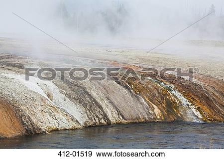Stock Photograph of Rock formations in sand basin 412.
