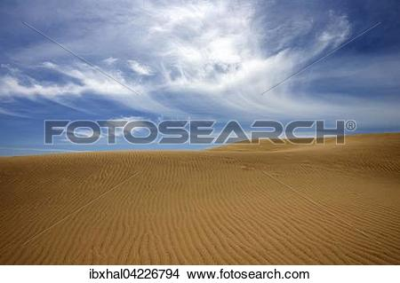 Stock Photo of Dunes, sand dunes of Maspalomas, cloud formation.