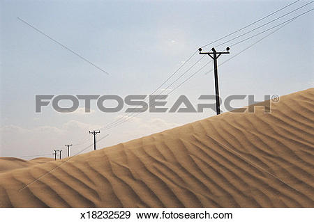 Stock Photograph of Diminishing Telegraph Poles in a Desert.