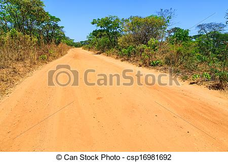 Stock Photographs of Abandon sand road in Africa through a forest.