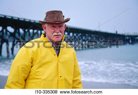Pictures of Portrait of a sand shrimp Fisherman with long pier in.