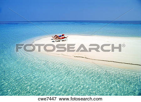 Picture of Two women relaxing in solitude on beach chairs on.