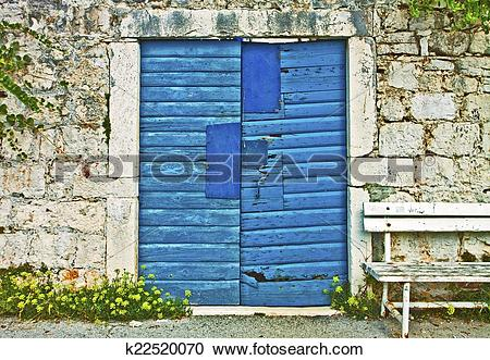 Stock Photography of Stone wall, vintage blue gate and wooden.