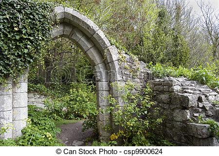 Stock Photo of old stone arch in park.