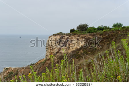 Cliff Side Sandstone Mountain Overlooking Ocean Stock Photo.