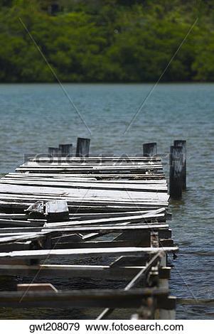 Stock Photograph of Damaged pier in the sea, Providencia y Santa.