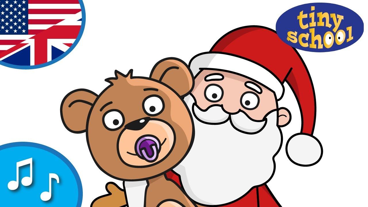 Baby bear celebrates Christmas with Santa.