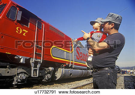 Stock Photography of A father and son in engineer caps look at a.