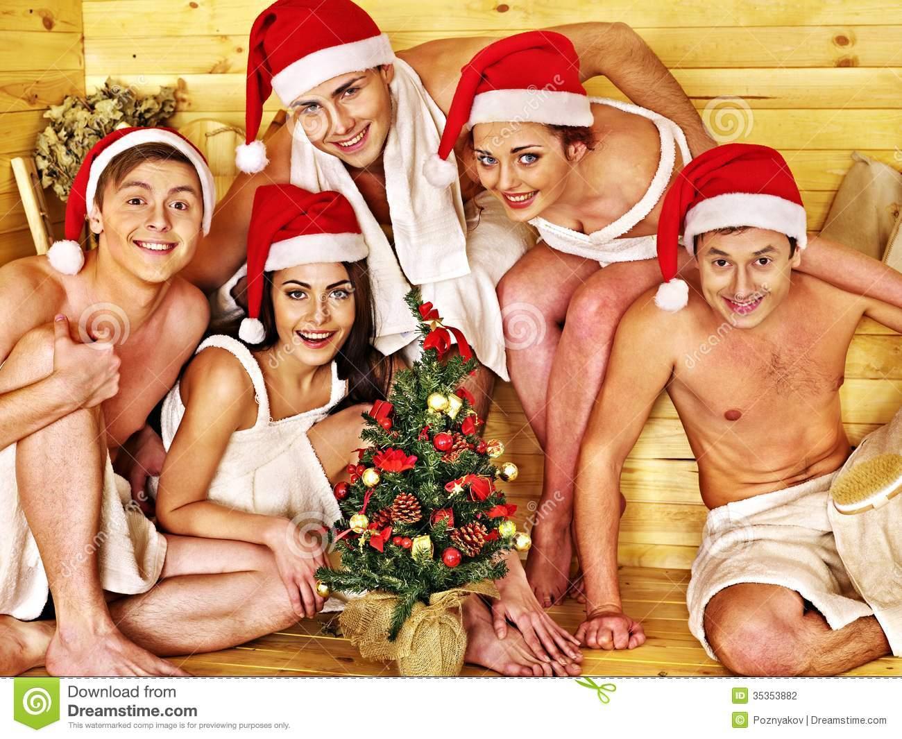 Group People In Santa Hat At Sauna. Stock Photos.