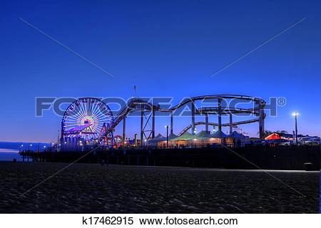 Stock Image of Old Ferris Wheel and Santa Monica Pier at Twilight.