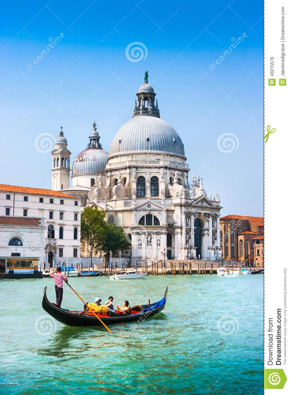 Traditional Gondola On Canal Grande With Basilica Di Santa Maria.