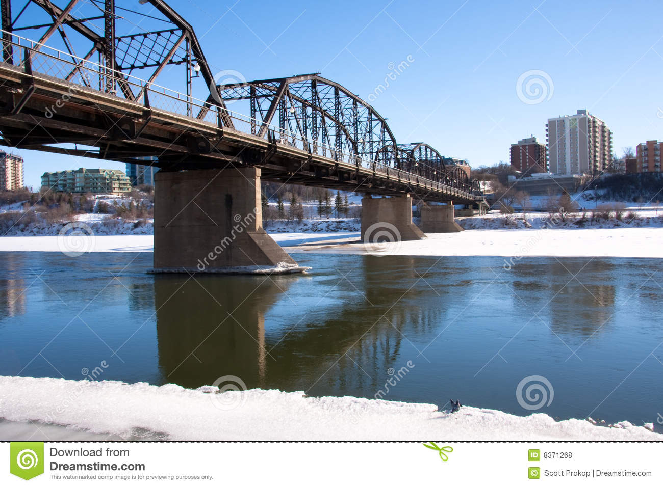Saskatoon Cityscape By The South Saskatchewan River Stock Image.