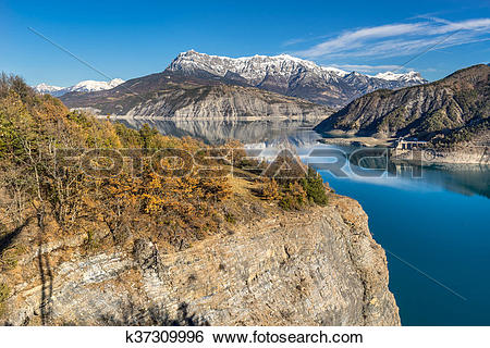 Stock Images of Serre Poncon lake and Grand Morgon in winter. Alps.