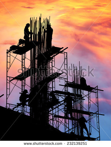 Silhouette Construction Workers On Metal Scaffolding Stock Photo.