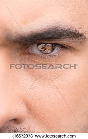 Pictures of Close up of male eye. Angry look, scared woman in eye.