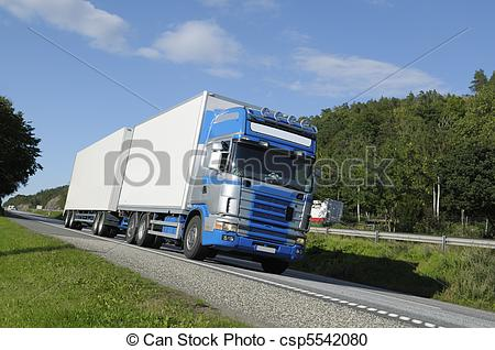 Stock Photography of trucking on scenic highway.