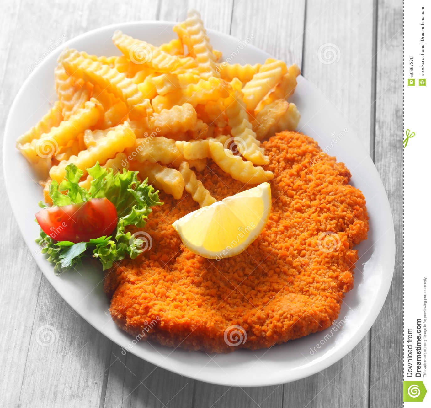 Gourmet Tasty Crumbled Schnitzel And Crispy Fries Stock Photo.