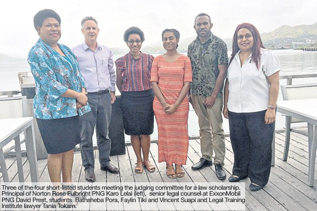 Global law firm supports four students from UPNG.