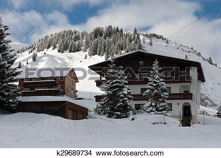 Stock Photo of Chalets on the side of a mountain, near the village.